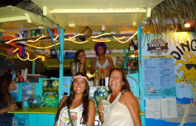 """Dinghys full moon party. Theme was Mermaids, butterflys and mythical creatures...the bikini wearer in the back is the male bartender that was nice enough to pose for us. Rachel was called """"Hawaii Girl"""" all night by everyone...love the headband!"""