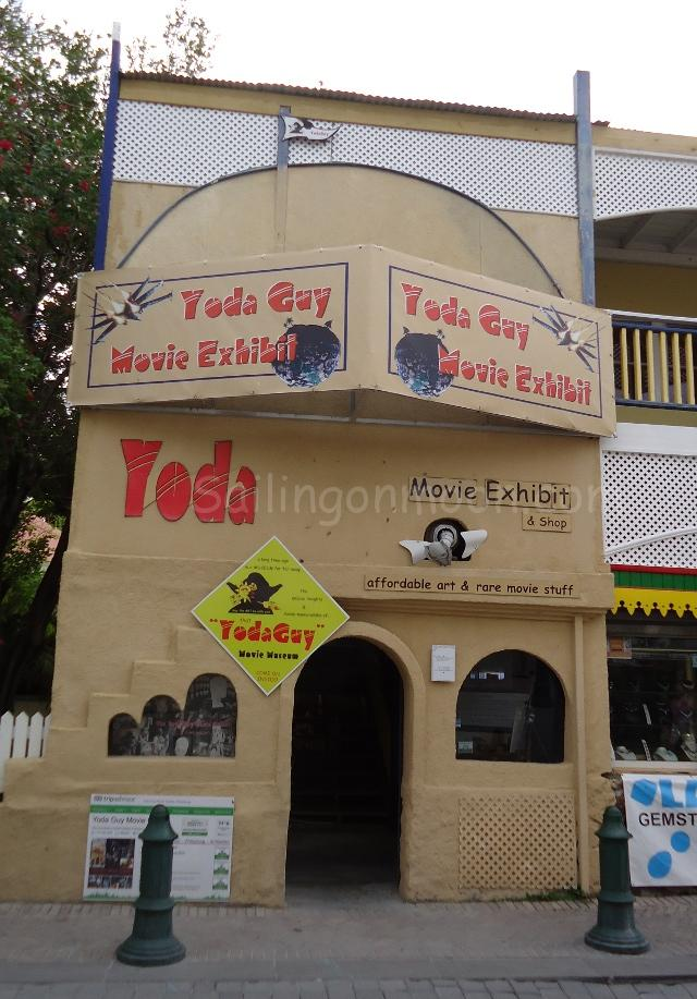 Nestled among bric-a-brac stores on Front Street, St. Maarten, The Yoda Guy Movie Museum. This speciality museum in Phillipsburg is owned by enterprising couple Nick and Gloria Maley. Nick is an international artist famous for his creation of Yoda and other infamous movie creatures. Known as That Yoda Guy, the special effects wizard and his wife were keen to share the inside story about the making of movie characters through their vast collection of life-casts, film relics, behind-the-scenes photos, storyboards, famous autographs and much much more.